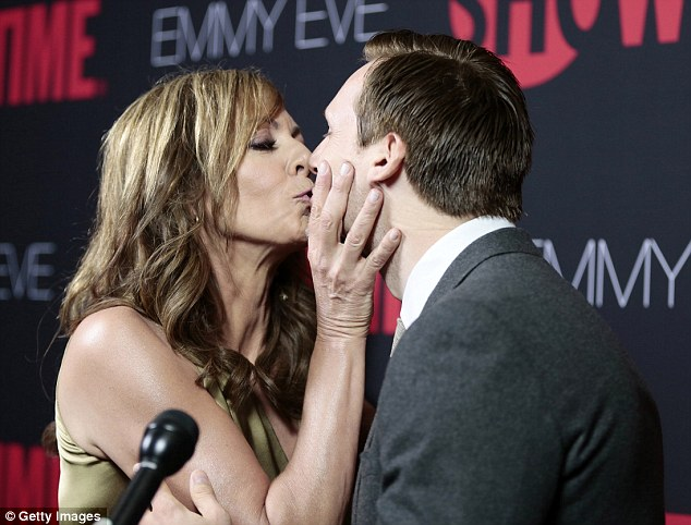 There you go: Allison has a kiss for Teddy Sears at the pre-Emmy event in West Hollywood on Sunday evening
