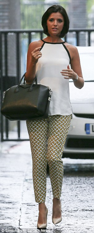 Pretty in print: The former TOWIE beauty chose a patterned pair of trousers (L)