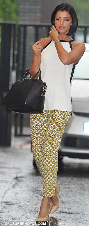 Turning heads: Lucy teamed her yellow print bottoms with a white and black blouse