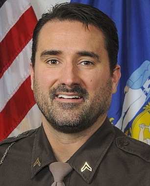 Accused: ex-Dane County sheriff's deputy Andrew Steele, pictured, has been charged with killing his wife and the woman's sister
