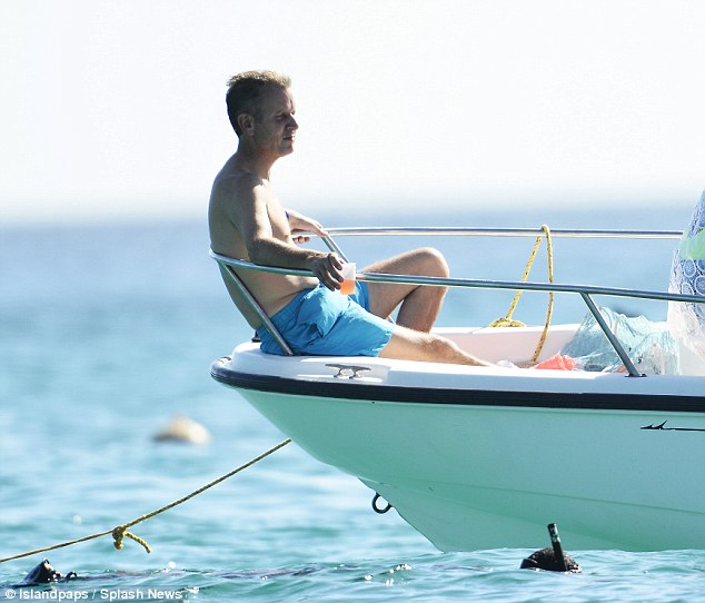And, relax! The 49-year-old didn't look to have a care in the world as he sipped a drink while sat in the sunshine