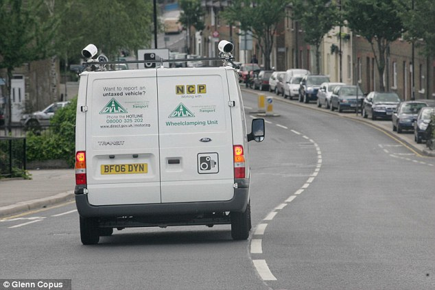Automatic number plate recognition cameras enforcing road tax, pictured here being used by DVLA teams, will be used to ensure tax discs are valid under the new digital system