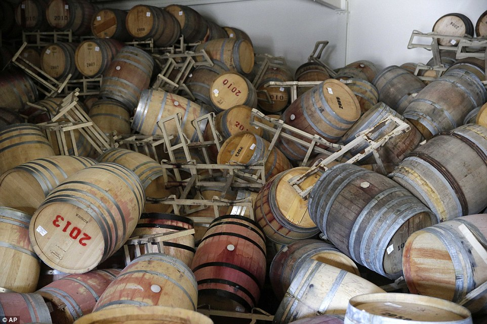 Barrels filled with Cabernet Sauvignon are toppled on one another following an earthquake at the B.R. Cohn Winery barrel storage facility.