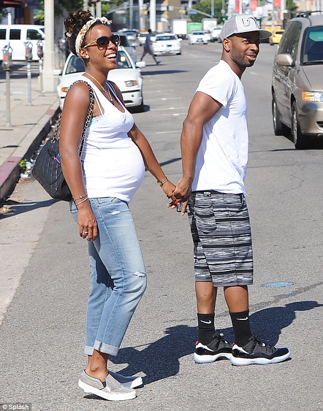 Her new husband: Kelly and Tim Witherspoon, seen out for lunch on August 18, married in Costa Rica in May in a secret ceremony witnessed only by their closest friends and family