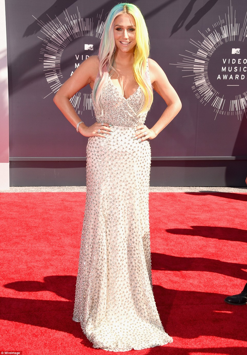 Radiant: Kesha shimmered in a low-cut white gown with short train and sparkling gems sewn into the fabric as she attended the MTV VMAs on Sunday