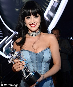 Top title: Busty Katy Perry was grinning with glee after receiving her Best Female trophy