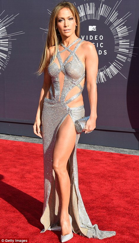 Smouldering temptress: Jennifer Lopez sizzled in a crisscrossing silvery gown that displayed her toned waist and shapely legs