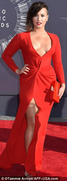 Riveting in red: Bailey Buntain, Rita Ora, Demi Lovato and Cher Lloyd heated up the carpet in their gloriously red dresses