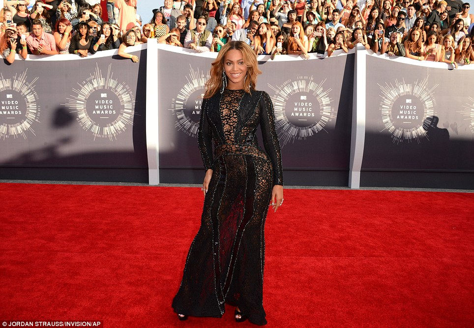 Star moment: Beyonce left little to the imagination in black lace dress that outlined her curvaceous physique