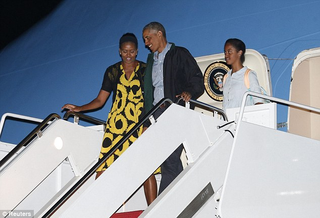 U.S. President Barack Obama,  First Lady Michelle Obama and daughter Malia returning from their two-week vacation on Martha's Vineyard