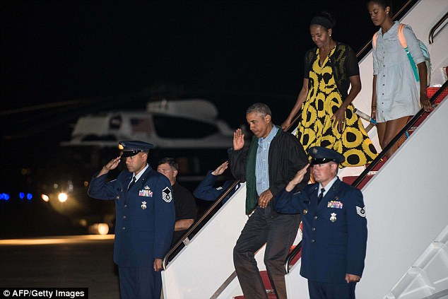 US President Barack Obama, First Lady Michelle Obama and daughter Malia walk off Air Force One at Andrews Air Force Base in Maryland