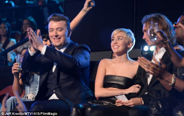 Singer Sam Smith shows his appreciation as Miley Cyrus beams and Jesse looks apprehensive before his big moment