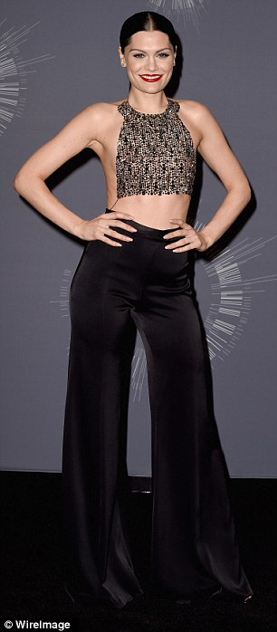 Top of the crops: Jessie showcased her toned abs in a slinky crop top, before slipping into a tiny minidress as she took to the stage later in the evening