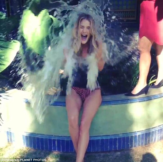 Model Rosie Huntington-Whiteley takes part in the ALS Ice Bucket Challenge - stripping to her undies for the big moment