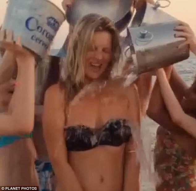 That ice-cool model look: Kate Moss was doused by multiple buckets as she accepted her nomination with gusto