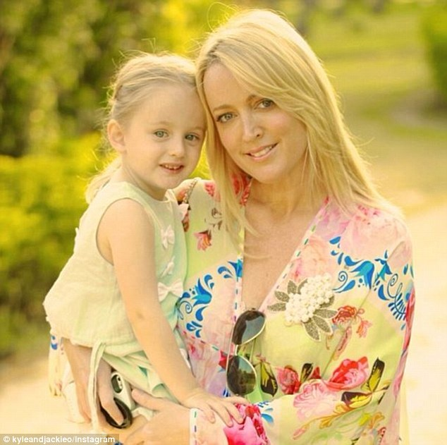 Motherly love: The popular blonde radio presenter and husband Lee Henderson are parents to 3 year-old Kitty