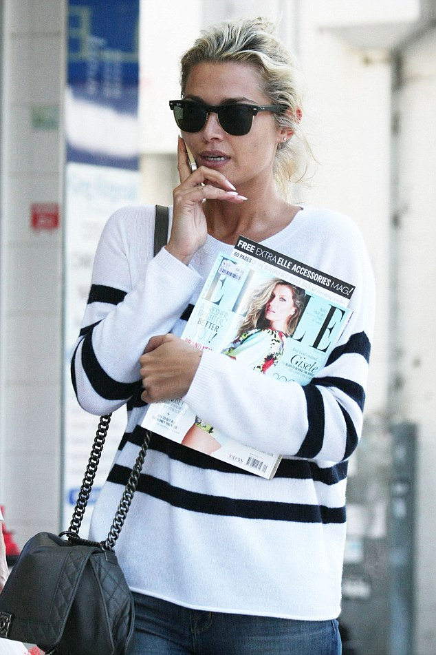 Gisele fan? Tozzi grabbed a copy of the latest issue of Elle magazine for some light reading later