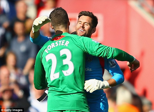 Goalkeepers' union: Foster and Forster embrace after Saturday's match ends in a goalless stalemate