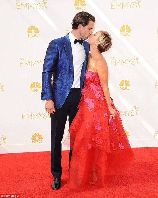 Pecks appeal: Kaley Cuoco and husband Ryan Sweeting shared a number of kisses as they walked the red carpet at the Emmy Awards at Los Angeles' Nokia Theatre LA Live on Monday