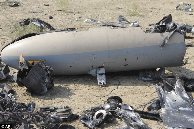 This photo, released by the Iranian Revolutionary Guards, claims to show the wreckage of an Israeli drone shot down by Iran near a nuclear site, 150 miles south of Tehran