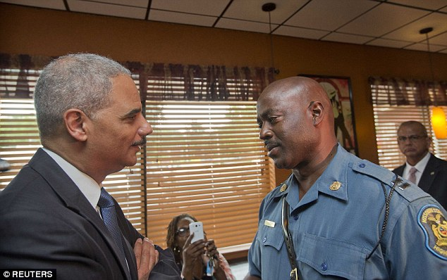 'My man! You are the man!' Eric Holder, the U.S. attorney general, greeted Missouri's top highway patrolman who was in charge of keeping peace on the streets of Ferguson, Mo. last week