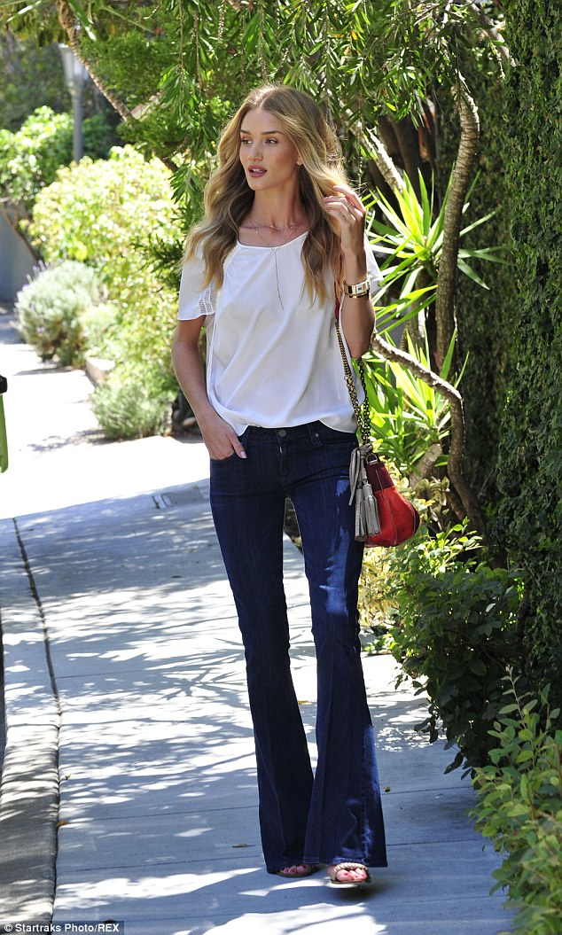 Radiant: Rosie Huntington-Whiteley flaunted her Victoria's Secret Angel curves in the bell bottom jeans