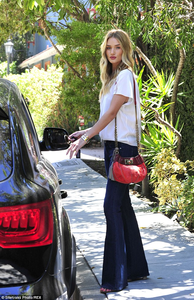 Heading home: Rosie reached for the keys in her handbag as she headed home from an eatery in Malibu