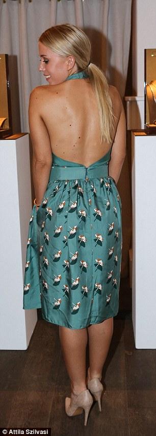 Co star: Also braving a blustery evening was X Factor Luke Jacobz's girlfriend Katie Hansen in a backless dress