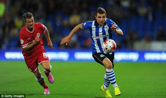In demand: Wigan midfielder James McArthur (right) is wanted by Leicester City, Burnley and Crystal Palace