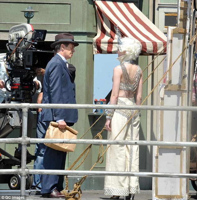 Lights, camera, action: The acclaimed actor seen filming a scene in the searing sunshine