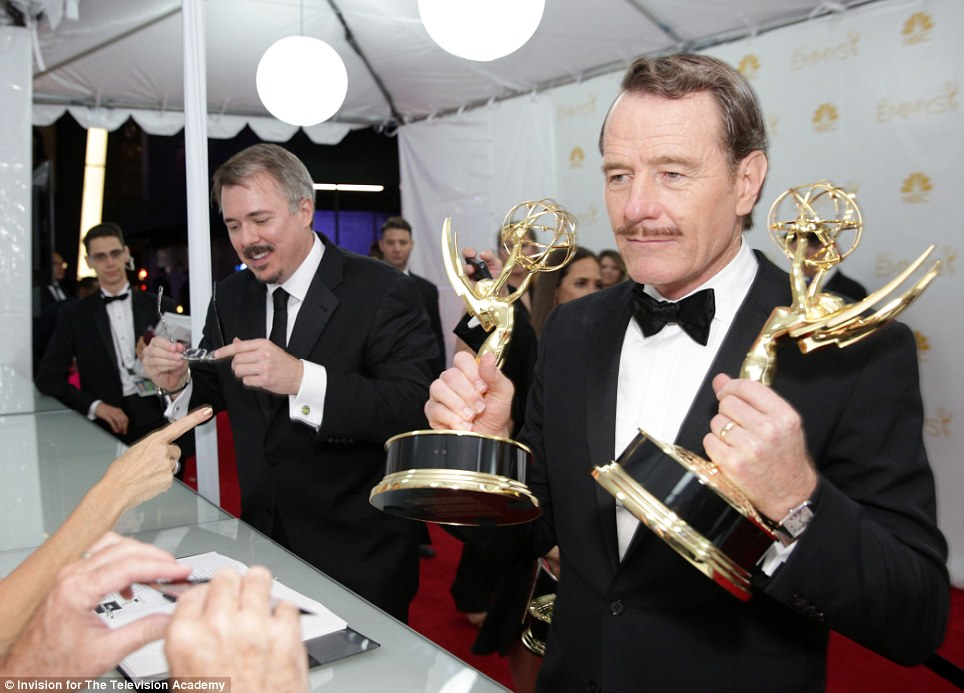 Proud moment: Bryan Cranston posed with the show's Best Drama Series trophy and his Best Actor prize after the ceremony