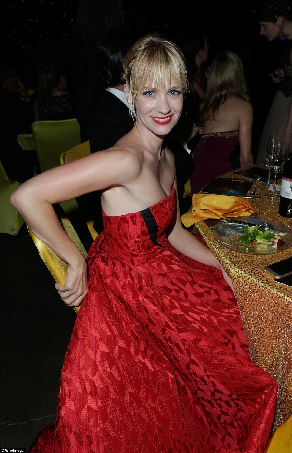 Red-dy to party: January Jones looked fresh-faced as she prepared to let her hair down with her fellow thespians