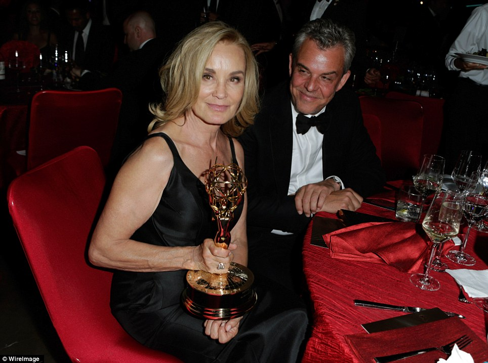 Leading lady: American Horror Story: Coven star, Jessica Lange, proudly showed off her latest gong as she sat alongside actor Danny Huston