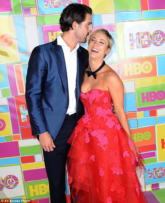Much to smile about: Ryan whispered intently into Kaley's ear as she burst into laughter on the red carpet