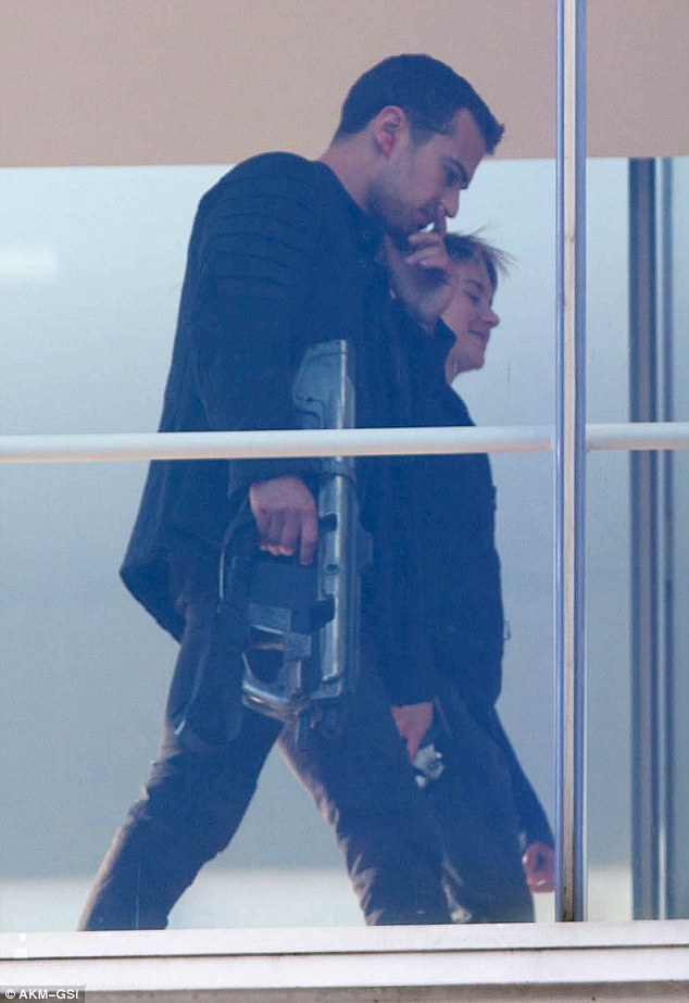 Ready for action: Theo and Shailene got ready to film one of the sequel's key scenes