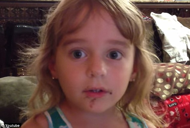 Nice try: In this comical YouTube video, Emma (pictured) fervently denies any involvement in the demolishing of a chocolate donut, despite her face being smeared with frosting