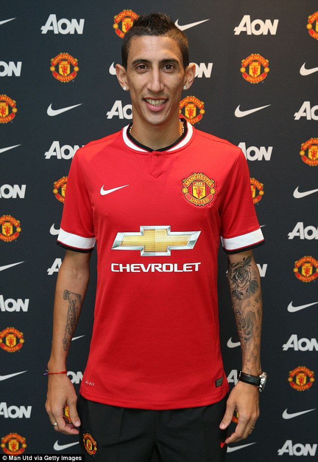 All smiles: United completed the signing of Angel di Maria for £60million from Real Madrid on Tuesday
