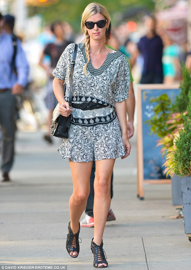 Sidewalk strut: The 30-year-old flashed her slim pins in a thigh-skimming monochrome dress on the day, complete with black waist belt