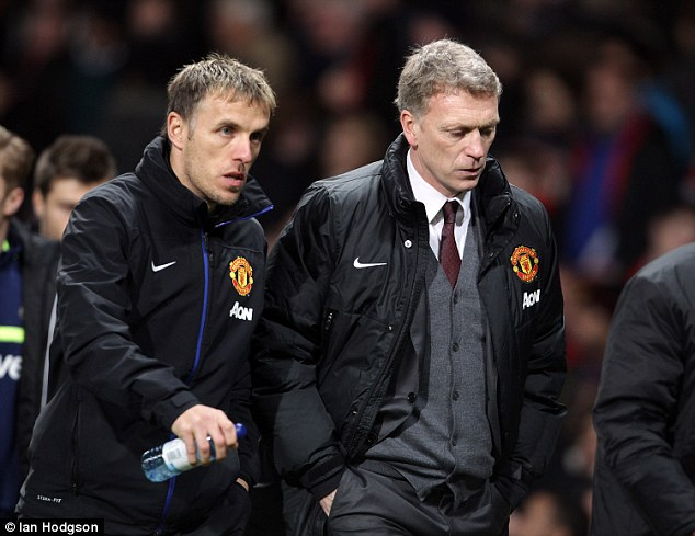 Ill-fated: Phil Neville spent last year as David Moyes' assistant manager at Manchester United