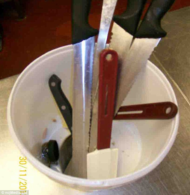 Dirty: Knives and utensils are stored in a dirty cup at the factory in Newcastle where staff failed to meet several health and safety regulations