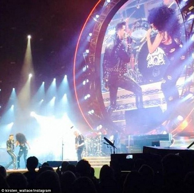 Rocking out: Gaga sang with Adam Lambert at the Queen gig on Wednesday night wearing her big curly wig