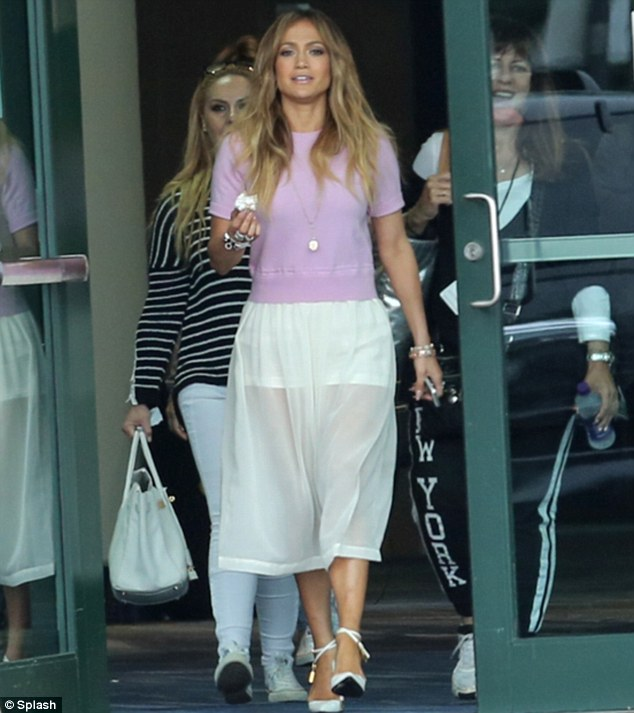 What a cover up: Jennifer Lopez left the American Idol auditions in New Orleans on Tuesday looking a lot more demure than her racy outfit at Sunday's VMA Awards