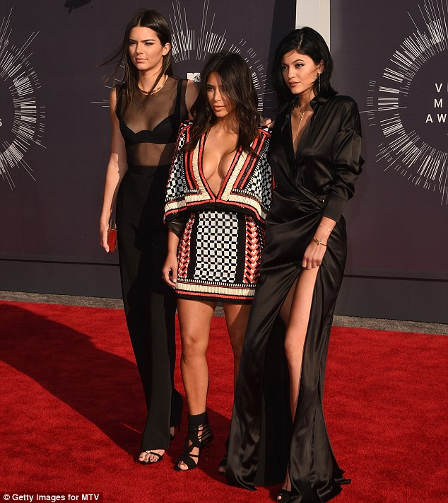 Three's company:Kendall and Kylie joined half sister Kim at the MTV Video Music Awards red carpet on Sunday in Los Angeles
