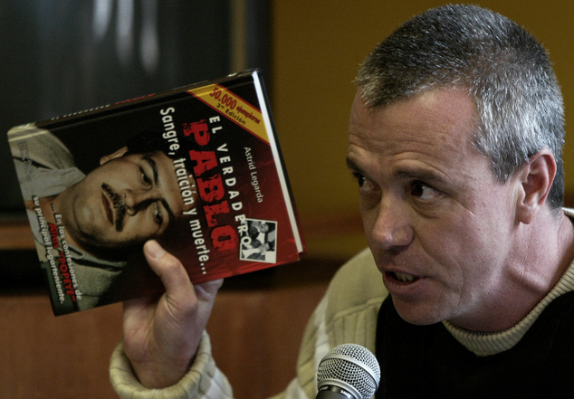 Witness: John Jairo Velasquez gives his testimony while holding a book titled The True Pablo, Blood, Treason, and Death, during the 2006 trial against Alberto Santofimio Botero in Bogota. He has been released from prison for 'good behaviour'