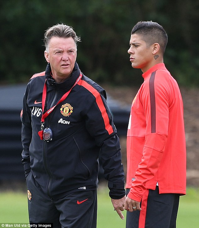 In training: Manchester United boss Louis van Gaal speaks to his new signing during training