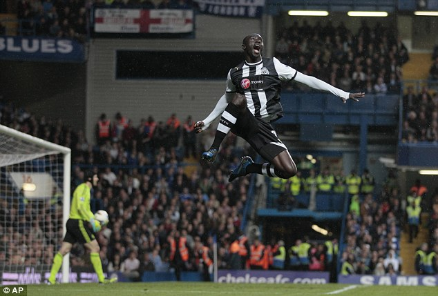 Better times: Papiss Cisse celebrates scoring against Chelsea at Stamford Bridge in May 2012