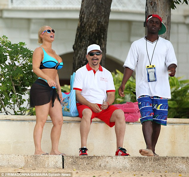 Laughs: The couple wait outside the resort after a fun snorkeling trip