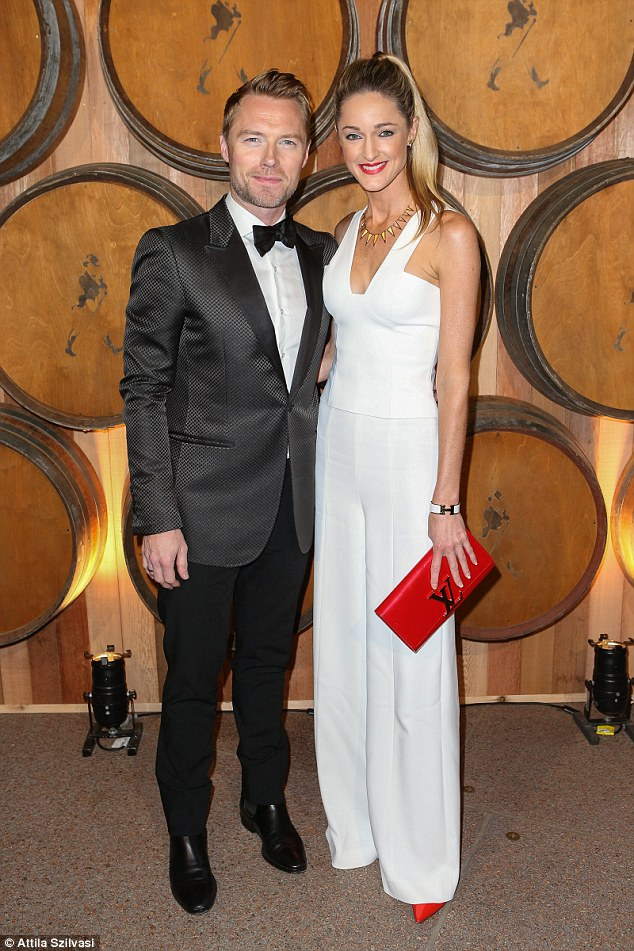 Immaculate: Ronan Keating and Storm Uechtritz looked very dapper as they arrived at the Sydney Opera House on Thursday night for a Johnnie Walker dinner