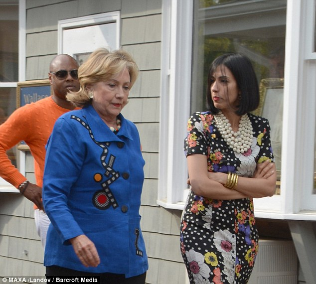 Former Secretary of State Hillary Clinton, shown August 16 in the Hamptons with longtime aide Huma Abedin (right), pushed for President Obama to arm anti-Assad groups last year, including some that may now be part of ISIS