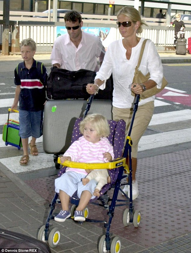 Ulrika with her ex-husband Lance Gerrard Wright and two children Cameron (left) and Bo (centre) at Heathrow airport in 2003